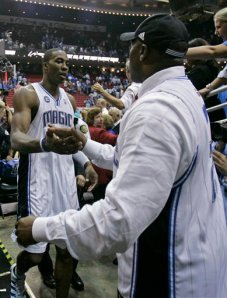 Recognize the Fellow Dwight Howard Is Shaking Hands With?  It's Nick Anderson.  That Cannot Possibly Be A Good Thing for Orlando.